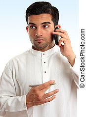 Ethnic business man using phone - Ethnic mixed race...