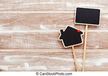 House sale sign on wood background - House sale and rent...