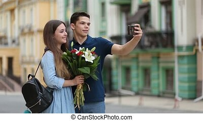 Loving couple talking self portrait with phone - Smiling...