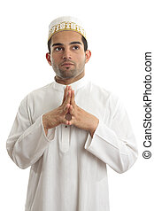 Ethnic man traditional clothing thinking looking up