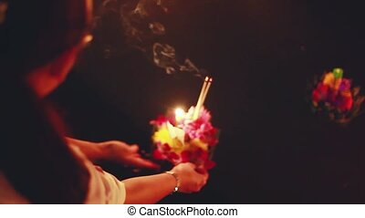 Loy Kratong Festival celebrated in Thailand. Hands Launches...