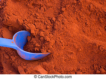 Cayenne pepper with spoon - Close up of plastic scoop in red...