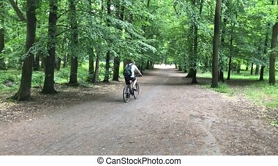 Man riding on bike in the park
