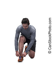 Sporty asian man sit down tying shoelaces ready for running...