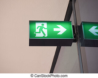 Emergency exit sign - Green light emergency exit fire escape...