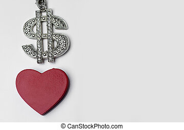 The dollar sign and heart on a white background.