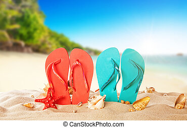 Tropical beach with colored flip flops, summer holiday background.