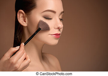 Beauty Girl with Makeup Brush. Perfect Skin. Applying Makeup...