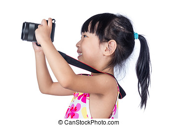 Asian Little Chinese girl holding a camera
