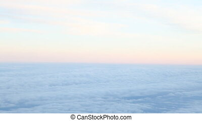 the sky above the clouds at sunset from
