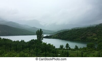 Lake at rainy day in summer