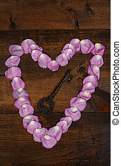 pink rose petal heart with key