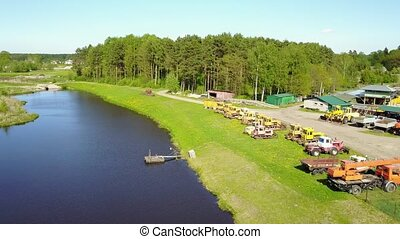 Tractors bulldozer technics at lake coast Aerial view, drone...