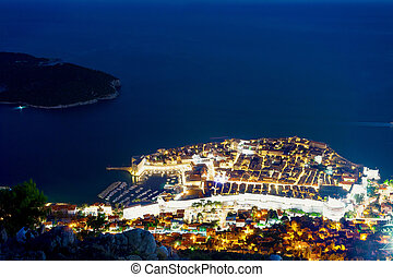 Aerial night view of Dubrovnik Old town with Adriatic Sea