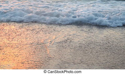 sandy beach waves at sunset Ocean