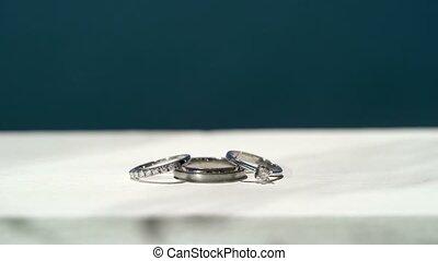 Wedding rings near sea at sunny day