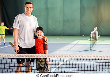 Happy parent and child enjoying playtime together - Tennis...