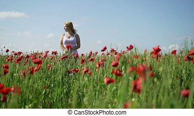 Young woman in poppy field