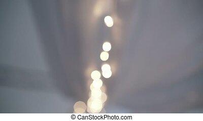 Lamp garland blur on white background