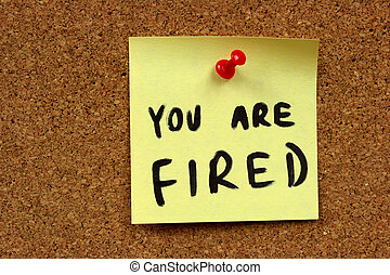 Job dismissal notice - Yellow small sticky note on an office...