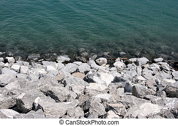 Lake coast - Water and stone coast - abstract background...
