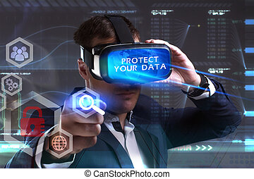 Business, Technology, Internet and network concept. Young businessman working in virtual reality glasses sees the inscription: Protect your data