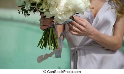 Young woman sitting with bouquet