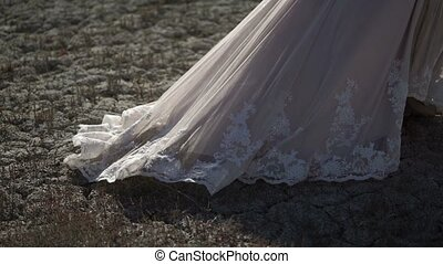 Bride walking on the ground