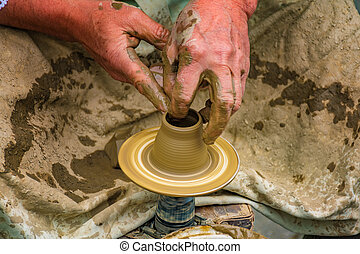 Pottery making on a pottery wheel