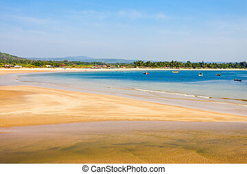 Beach in Goa, India - Beauty lonely beach with lagoon and...