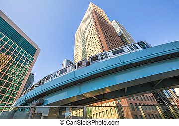 Monorail in Shiodome - Wide angle view of elevated monorail...