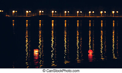 Lighting water Lanterns on river at night - Floating...