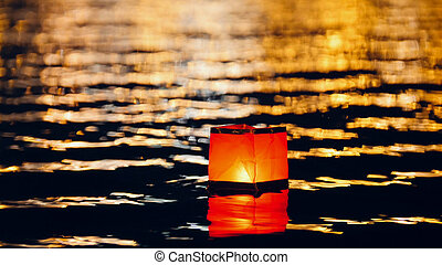 Floating lighting water Lanterns on river at night,...