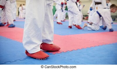 Karate training - group of karateka teenagers in kimono