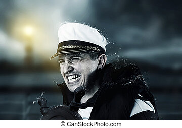 helmsman with vest and cap struggle against storm in front...