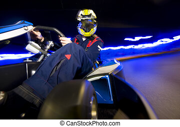 Go-Cart racing driver - Racing driver leaning towards the...