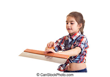 Little girl holding putty knife - Little pleasant girl with...
