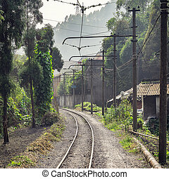 Electric narrow-gauge railway from Shixi to Bagou. Jiayang...