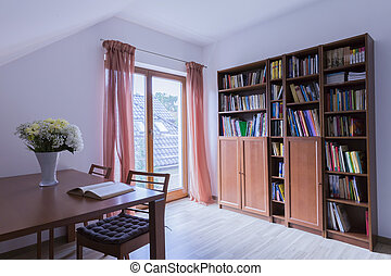 Office with wooden table and bookstand - Home office with...