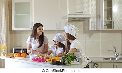 Sisters with Mom at Home in Kitchen Having a Good Time.