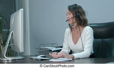 Young asian operator talking with customer in international call center