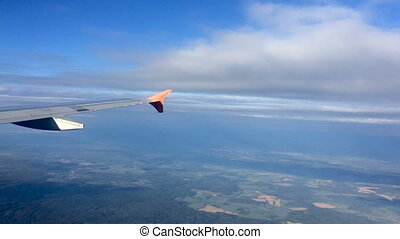 view from airplane on clouds with the right wing