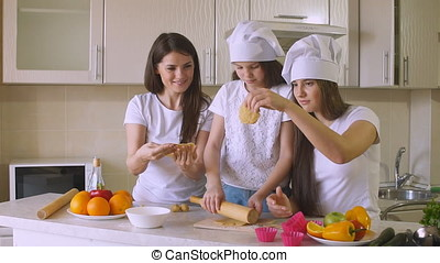 Sisters with Mom is Cooking in Kitchen, Slow Motion.