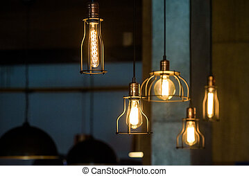 Industrial pendant lamps against rough wall. Loft interior....