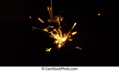 Sparkles of bengal fires at black background in the night