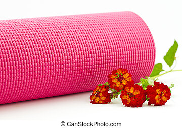 Pink yoga mat with colorful lantana flowers