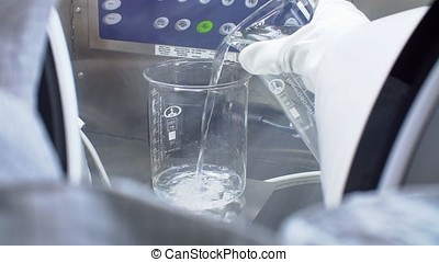 Scientists Working on Pharmaceutical Industry in a Clean...