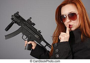 Woman with an assault gun