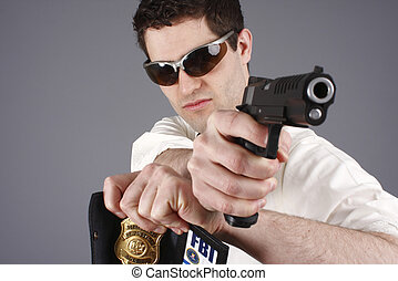 FBI agent aiming a pistol