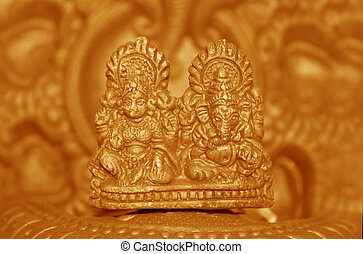 Hindu God Idols - A clay lamp with idols of Lord Ganesh...